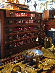 I would love to own this George Clark spool cabinet C. 1880-1910. The O.N.T. drawer stands for Only New Thread.The customers would come in to the store and look in this drawer to see what new colors were available that month.