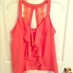 Coral Lauren Conrad tank Pictures do not capture the beauty of this top. But I'm sadly re-poshing because it doesn't fit me. Runs big in my opinion. Could fit a small with a large chest or medium for a fitted look. Lauren conrad  Tops Tank Tops