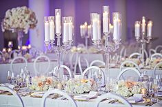 Crystal Candelabra and Purple Lighting  Photography: Carasco Photography Read More: http://www.insideweddings.com/weddings/southern-charm-and-modern-touches-with-peach-details-in-chicago/1065/ #weddingphotography
