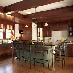 Contrasting Kitchen Islands - Kimberly Warren - Contrasting Kitchen Islands Kids and guests can pull up a seat to this bar-height island and be part of the action. The green color contrasts the rich wood cabinetry in this traditional kitchen. Kitchen Island Bar Height, Painted Kitchen Island, Painted Island, Modern Kitchen Island, Wooden Kitchen, New Kitchen, Kitchen Islands, Kitchen Ideas, Timber Kitchen