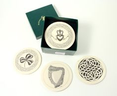 """Celtic and Irish Symbols Resin Coasters - Set of 4  Price : $49.95 Irish coaster set features 4 cream colored resin coasters with Irish and Celtic designs in black. Includes many popular Irish symbols: Claddagh, Shamrock, Celtic Weave and Irish Harp. Each coaster is 3-3/4"""" in diameter with a felt lining on bottom to protect your furniture. Made by Robert Emmet Co - a premier maker of Irish & Celtic Goods. http://www.biddymurphy.com/Celtic-Irish-Symbols-Resin-Coasters/dp/B009WRFZ70"""