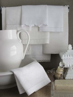 layered antique handkerchiefs and napkins as bath hand towels