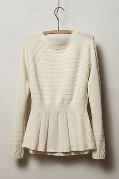 white peplum sweater