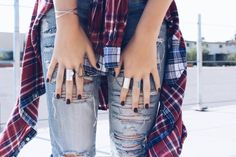 Yo, grunge queen. Heavy jewelry and plaid is for life!