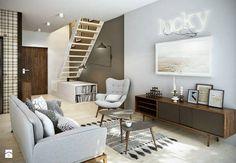 salon w małym mieszkaniu,szaro-brązowy salon,męski styl w salonie,salon w otwartej zabudowie mieszkania,schody w salonie,dwupoziomowe mieszkanie,aranzacja w męskim stylu,mieszkanie dla mężczyzny,szary kolor w mieszkaniu,drewniana komoda w nowoczesnym stylu,szara sofa nowoczesna,nowoczesna aranzacja salonu,marokański dywanik,,elipsowate stoliki kawowe,stolik elipsa w nowoczesnym stylu,pikowany fotel szary w nowoczesnym stylu,nowoczesne meble do salonu,grafiki na ścianę