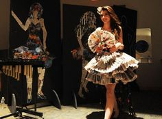 Model Erika Torres wearing The Enterprise newspaper during recycled fashion show at Bridgewater-Raynham Regional High School on Friday, April, 15, 2016. — Marc Vasconcellos/The Enterprise