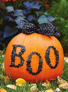 Different Buttons Spray Painted Black And Glued To A Pumpkin To Spell Out BOO Then Add A Bow To Finish It Off-Cute And Easy