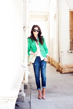 green blazer, jeans, and pumps