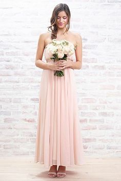 "The line features mostly flowy floor-length pieces in neutral hues, along with a few mid- and knee-length options. ""We didn't really go shorter than that because it doesn't really feel appropriate,"" Lauren told the mag. ""And if that's what you want, then you can always shorten the dress."" 