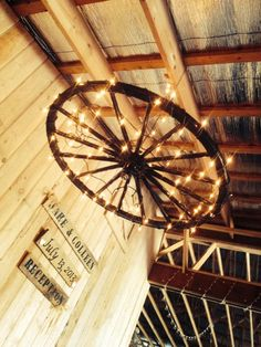 wagon wheel chandelier :)                                                                                                                                                      More Wagon Wheel Chandelier Diy, Outdoor Chandelier, Farmhouse Chandelier, Diy Chandelier, Backyard Lighting, Rustic Lighting, Wagon Wheel Light, Antique Farmhouse, Porch Decorating