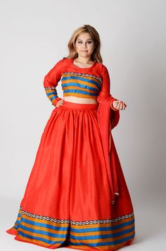 Matching printed border on the lengha bottom, sleeves, and bust. Perfectly balances every shape and angle. Ravishing red with a pop of color. Red, Mustard and blue. Long Lengha, with a with our Signature tie back blouse. Tie Backs, Anarkali, Color Red, Indian Fashion, Mustard, Shape, Pop, Printed, Blouse