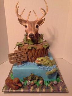 Hunting/fishing themed cake.  First time using modeling chocolate for the...