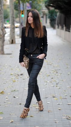 ombre hair, black peek-a-boo top, jacket w/gold accent, glitter clutch, leather pants, leopard boots worn w/confidence!