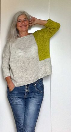 Spark is a lightweight (slightly cropped) wool sweater featuring a vibrant intarsia block and matching sleeve!