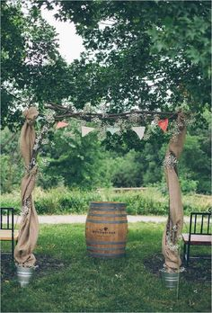 Wedding ceremony arch with bunting and burlap