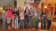 """12 Pin-loving girls gathered together for a night of fun & love of pinterest. Everyone brought a food/drink they'd pinned; we had demos (felt/material flower-making); a show & tell of previous crafts/ideas; crafted 5 items (bucket list, glow jar, t-shirt scarf, twine-wrap frame, mossy initial); had party favors (wine glasses) & take-homes (father's day activity, bookmarks) All ideas from pinterest!  We even had """"Pin Awards"""" (Best Overall Pinboards,etc..)  Very fun!  We hope to do it again…"""