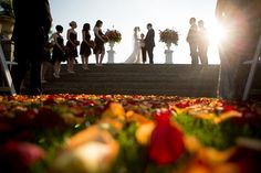 Flower pedals line the aisle during a wedding ceremony at Trump National Golf Club in Bedminster.#njwedding#njweddingphotographer#trumpnational#weddingflowers