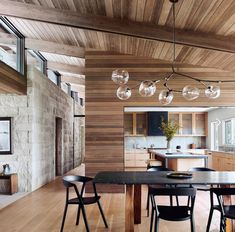 Smooth wood compliments rought stone inside this dream cabin - Lake Flato Residential Design, Luxe Interiors, Interior Styling, Austin Interior Design, Flooring, Hardwood Installation, Installing Hardwood Floors, Kitchen Dining, Stone Interior