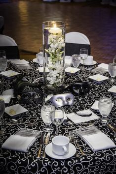 Black & White Masquerade Table Setting. Events By Vento Designs. We Go Beyond Fundraising & Corporate Events...Complete & Month-Of Wedding Services! Visit Us: www.eventsbyventodesigns.com