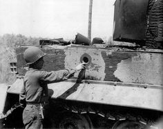 """ Killed "" Panzerkampfwagen VI Tiger . Note the hole . The granate penetration shows the thickness of the side panzer ..."