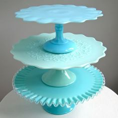 the top cake stand is c. 1900, the middle is Fenton's green pastel 'Spanish Lace' from 1954, and the bottom is Fenton's turquoise Silver Crest from the 1950s.