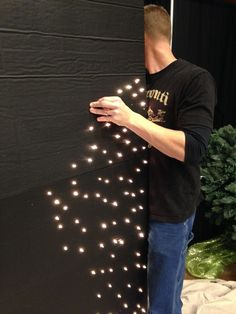 starry night back drop: compressed styrofoam, black paint & Christmas lights