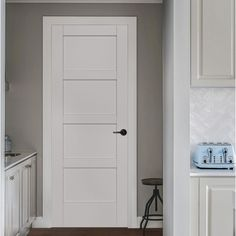 JELD-WEN 36 in. x 80 in. MODA Primed White 4-Panel Solid Core Wood Interior Door Slab