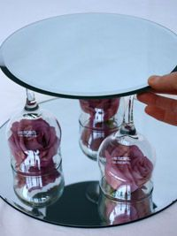 Wine Glass Centerpieces - - Use wine glasses for more than just drinking with. Whether you are having a wine themed wedding, or just looking for different options for centerpieces, there are many cute and unique ways to use w…. Wine Glass Centerpieces, Candle Wedding Centerpieces, Wedding Decorations, Centerpiece Ideas, Fishbowl Centerpiece, Diy Candle Centerpieces, Mirror Centerpiece, Graduation Centerpiece, Quinceanera Centerpieces