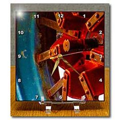 A close up of a wheel on an old farm tractor in red Desk Clock
