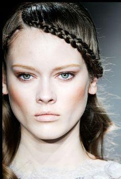 High cheekbones and a waterfall braid