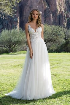 Slim A-Line Gown with Illusion Bodice and Eyelash Lace Justin Alexander Wedding Dresses will be stock in The Persnickety Bride in December 2017!
