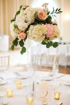 Tall wedding centerpieces not only look stunning, but are also functional- adding tons of dimension to your wedding decor and allowing guests to easily converse from a distance. Trumpet Vase Centerpiece, Tall Wedding Centerpieces, Wedding Flower Arrangements, Floral Centerpieces, Reception Decorations, Floral Arrangements, Rose Gold Centerpiece, Centerpiece Ideas, Mauve