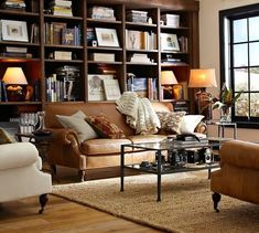 Mistakes Guys Make When Decorating To Impress Women | Laurel Home - Another handsome living room that guys and gals would love! From Pottery Barn!
