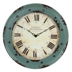 Antiqued wall clock in mint green with Roman numerals.   Product: Wall clockConstruction Material: WoodCo...