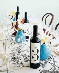 Get your drink on - table number on wine bottles.