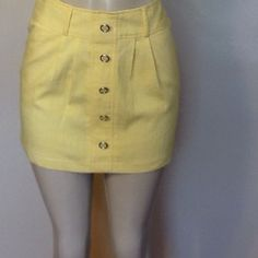 "Charlotte Russe Skirt Cute yellow mini skirt. NWT.  Faux button front, side pockets.  12"" length, side zipper.  Summer perfect!   Bundle and save!. No Trades.  Offers welcome but no low-ballers please.  Happy Poshing. Please use ""Offer"" to negotiate. Charlotte Russe Skirts"