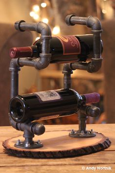 Wine Rack for rustic log cabin or mountain home created by Industrial Metal Sculptor Andy Nortnik. Copyrighted Design.