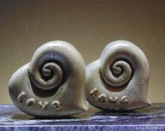 """This is a rustic heart shaped cement paperweight with a swirl and the word """"Love"""" on the top. I have rubbed it with a dark wax to give it a more earthy look. There are 2 pictured. This listing is for Cement, Concrete, Dark Wax, Paper Weights, Earthy, Heart Shapes, Bubbles, Christmas Gifts, Stud Earrings"""