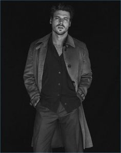 Front and center, François Arnaud wears a Prada coat. He also sports a Vivienne Westwood shirt and Caruso pants.