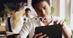 Mixed race man using digital display touchscreen tablet ipad device in cafe Stock Footage,#digital#display#touchscreen#Mixed