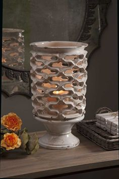 A one of a kind piece, the Calandra hand made clay lantern features a cream glaze and unique pattern. Holds pillar candles. Product Description Product Material