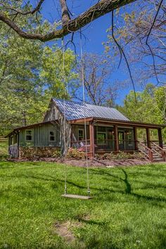 Located in the sleepy little town of Leiper's Fork, Tennessee, 30 miles southwest of Nashville, this charming cabin is the perfect vacation rental. There are two tree swings, including one at the edge of a creeks that runs through the property. Cabin Homes, Cottage Homes, Log Homes, Cabins In The Woods, House In The Woods, House In The Country, Cottage In The Woods, Country Living, Tennessee Cabins