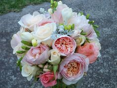 Gooorgeous!! Mix of pink david austin roses, smaller Evelyn david austin roses, pale pink Sweet Avalanche roses, and freesias.