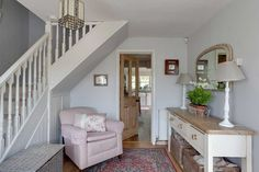 Using floral prints and a pastel palette, June Willison and Barry Monk have turned an unloved Victorian cottage into a charming country-style home