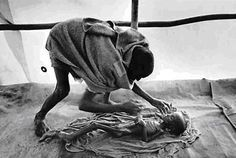 Sebastião Salgado, father preparing his child for burial.  Died of Starvation