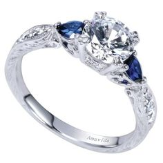 This is my dream engagement ring! I love the three stone look with sapphires on the side! So pretty and unique, plus it have the vintage engraving I like.