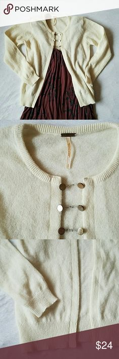 Free People cardigan size S EUC sweet little cardigan with beaded chain and button closure. 70%lambswool 20% angora 10% nylon  Length 20 inches chest armpit to armpit 15 inches Free People Sweaters Cardigans
