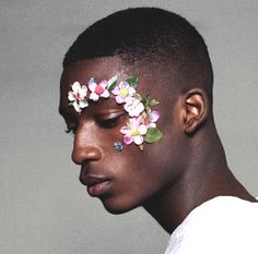 Harry Uzoka for Christopher Shannon  personal commment : i love seing bright flowers on dark skin, the contrast is wonderful
