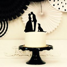 In honor of National Puppy Day, put your own pup on your wedding cake with a custom silhouette wedding cake topper.
