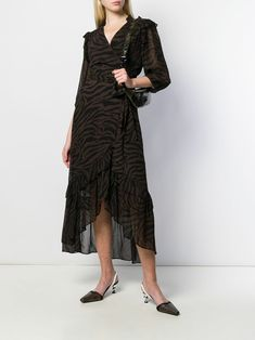 Brown wrap maxi Sele dress from BA&SH featuring a v-neck, an animal print, three-quarter length sleeves, a wrap style front, a frill trim and a long length.